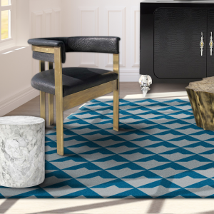 blue and grey rug with chair